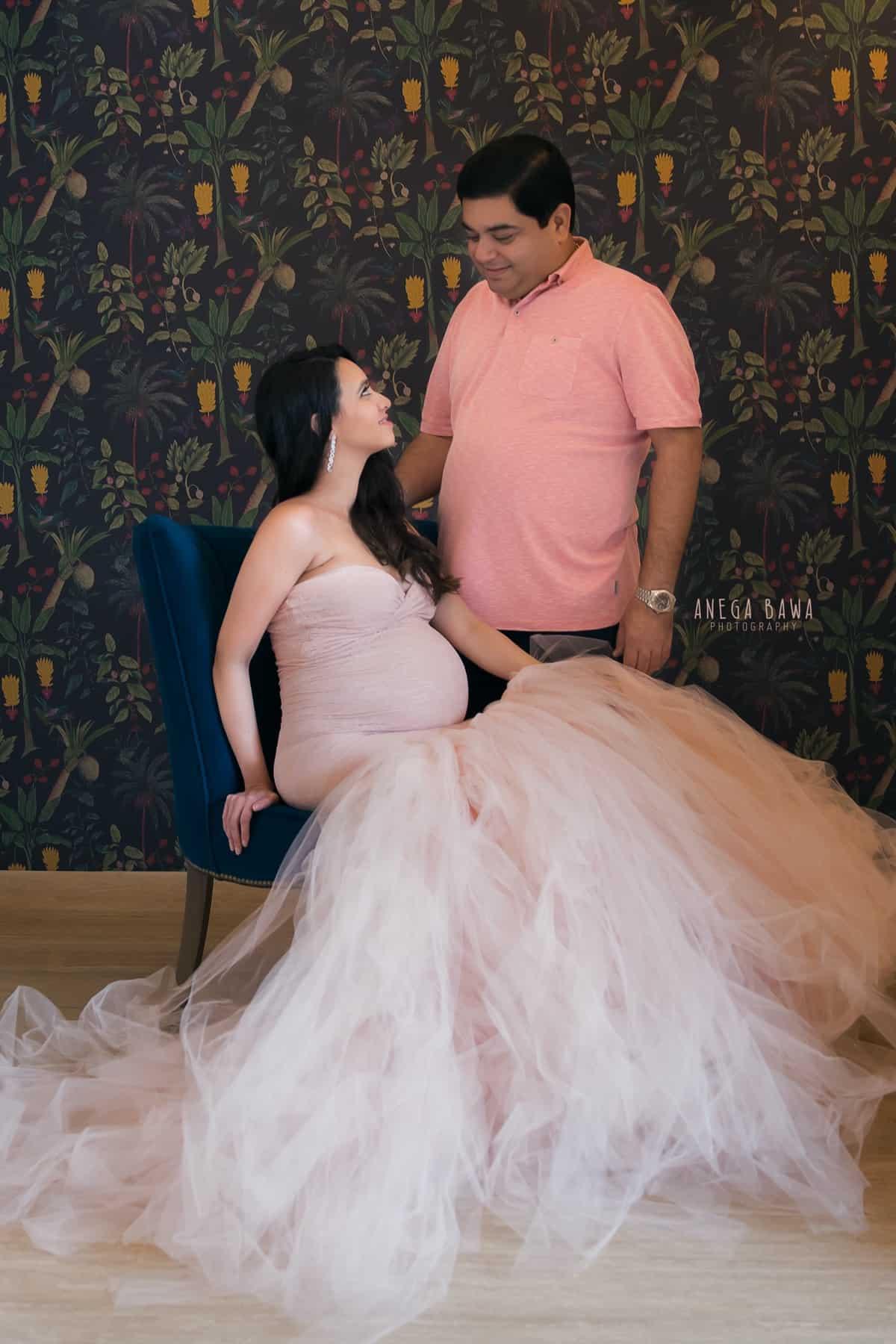 top maternity photography delhi gurgaon pink dress tropical background anega bawa