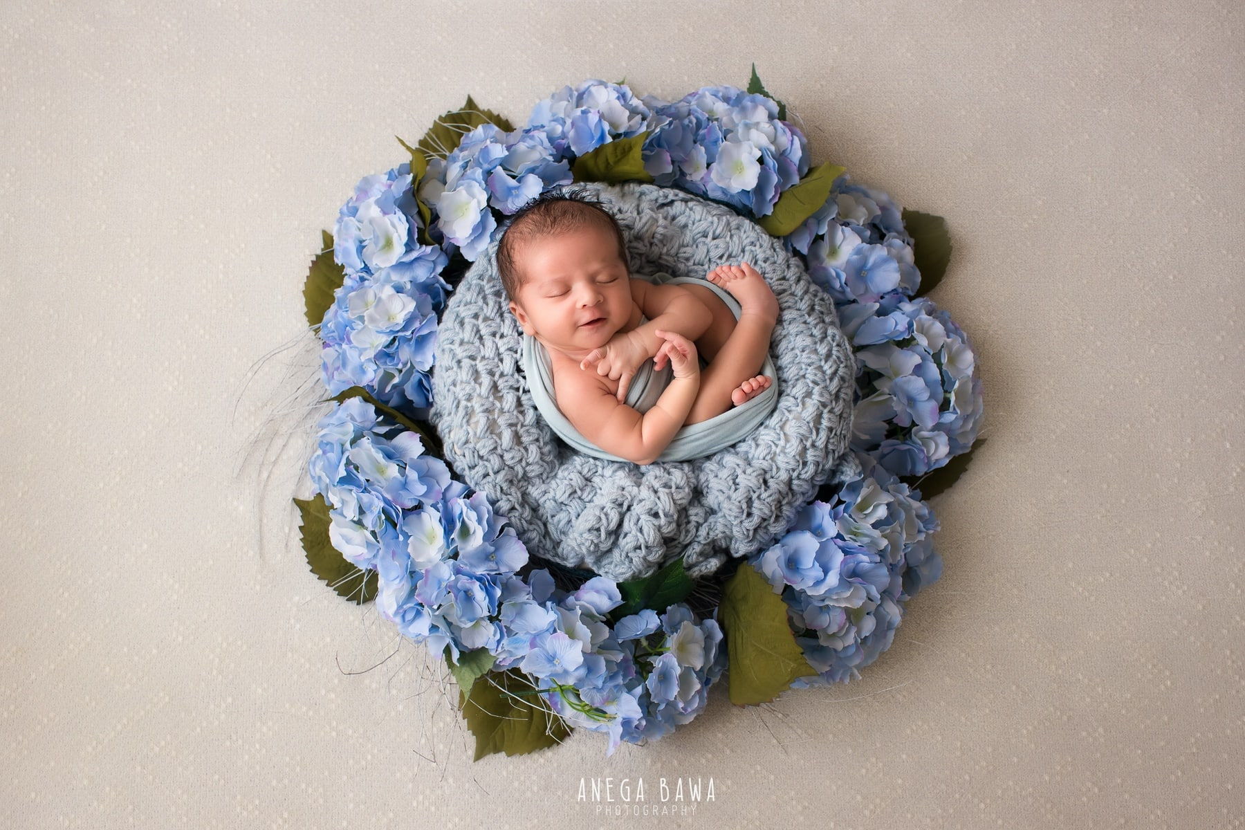 white floral newborn photography delhi 10 days baby boy photoshoot gurgaon anega bawa