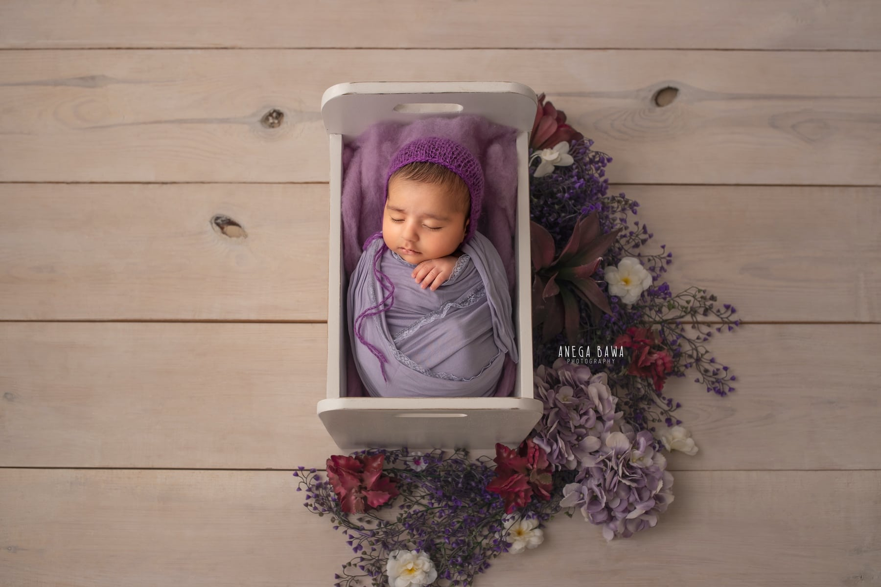 light wooden purple floral newborn photography delhi 20 days baby boy photoshoot gurgaon anega bawa