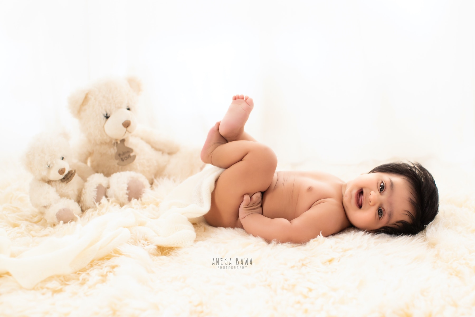 white fur baby photography delhi 5 months baby boy photoshoot gurgaon anega bawa