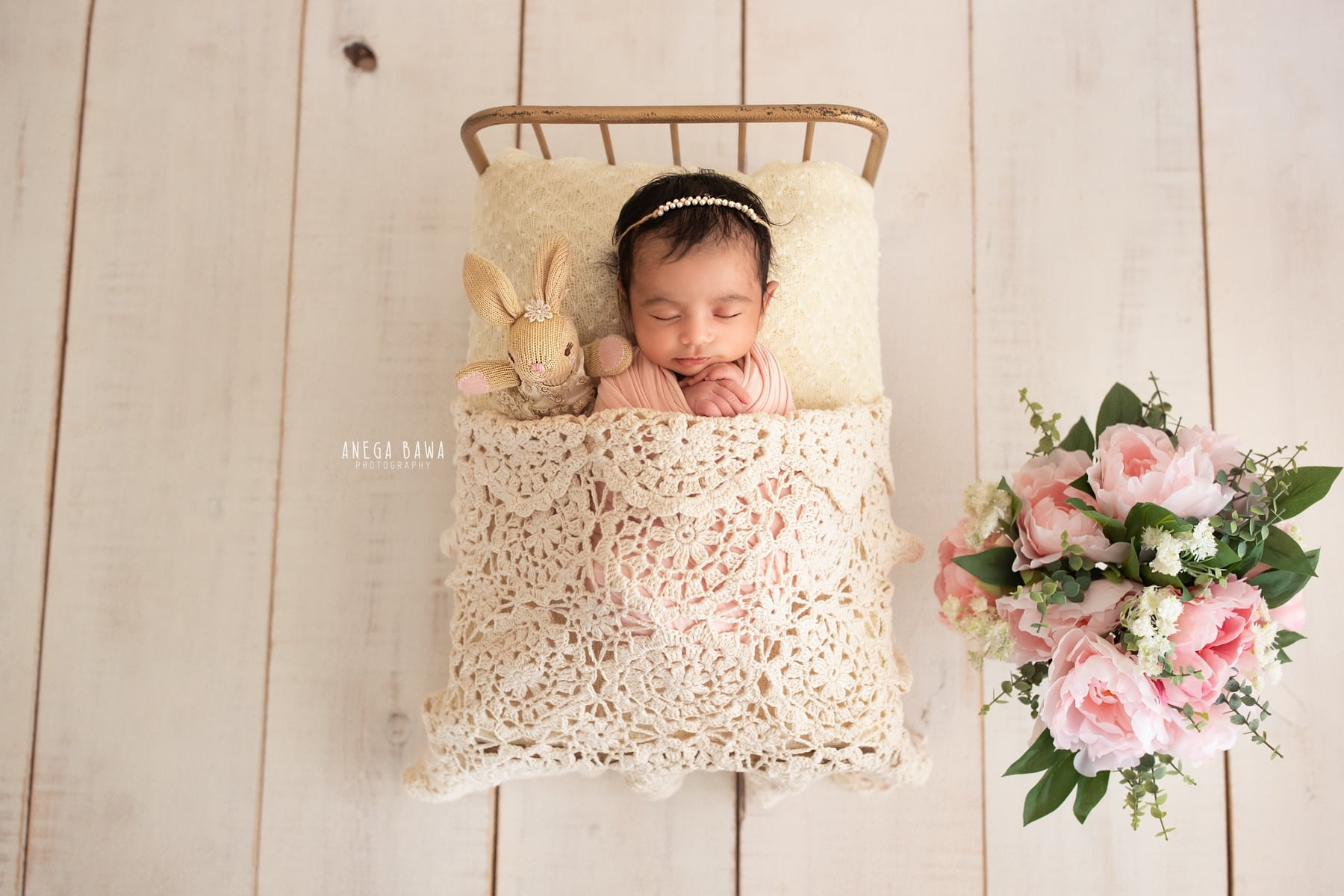 white pink flower newborn photography delhi 7 days baby boy photoshoot gurgaon anega bawa