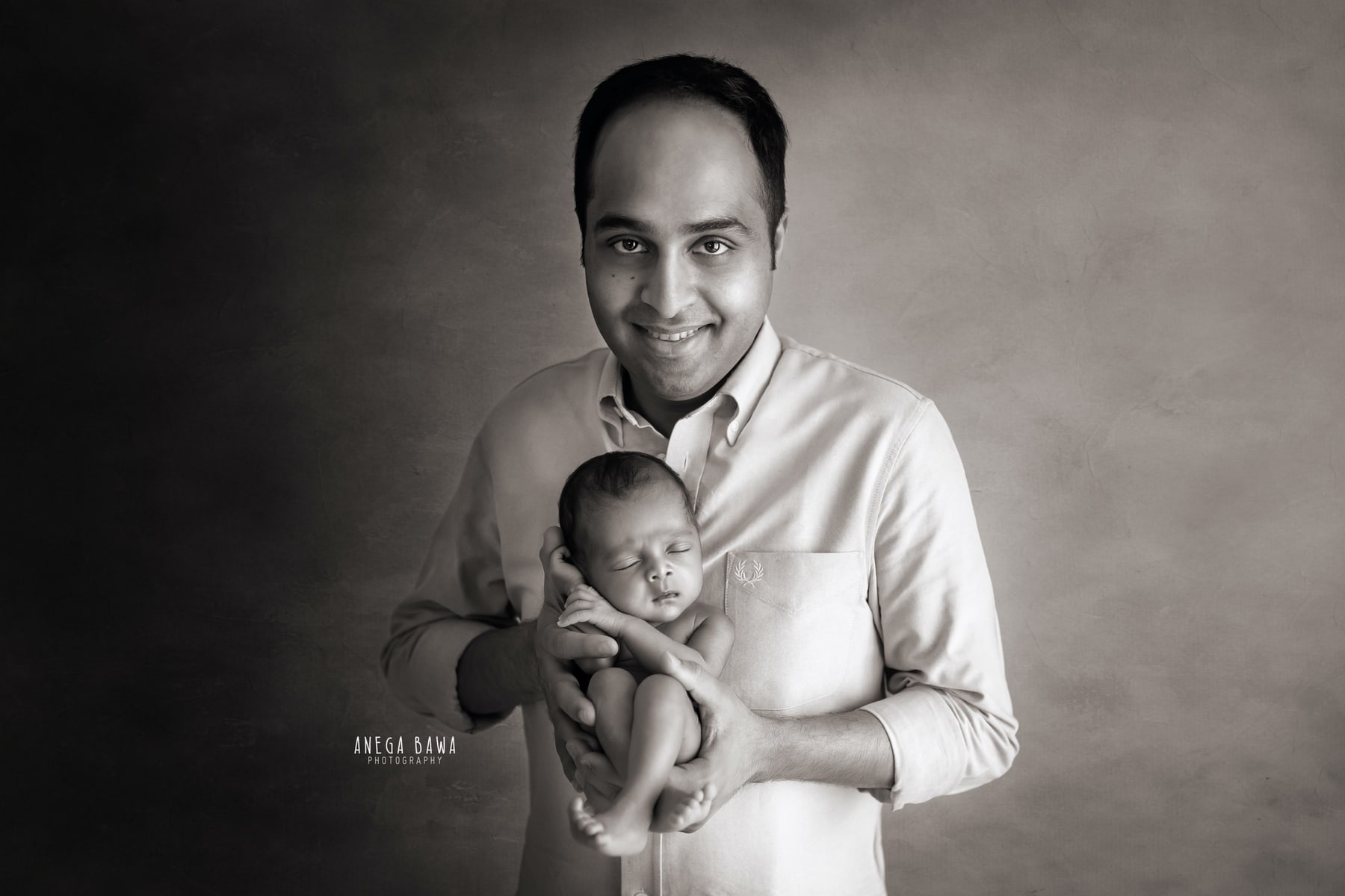 black white father and baby photography delhi 10 days newborn photoshoot gurgaon anega bawa