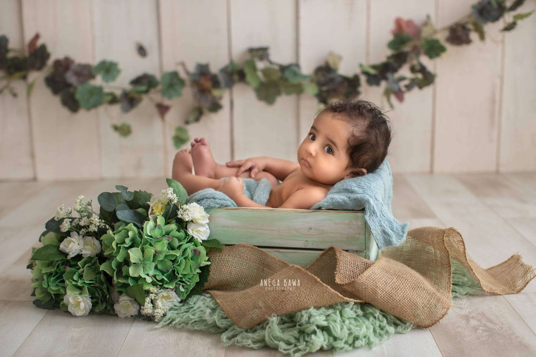 245601-white-wooden-background-green-floral-baby-photography-delhi-5-6-7-months-baby-photoshoot-gurgaon-anega-bawa