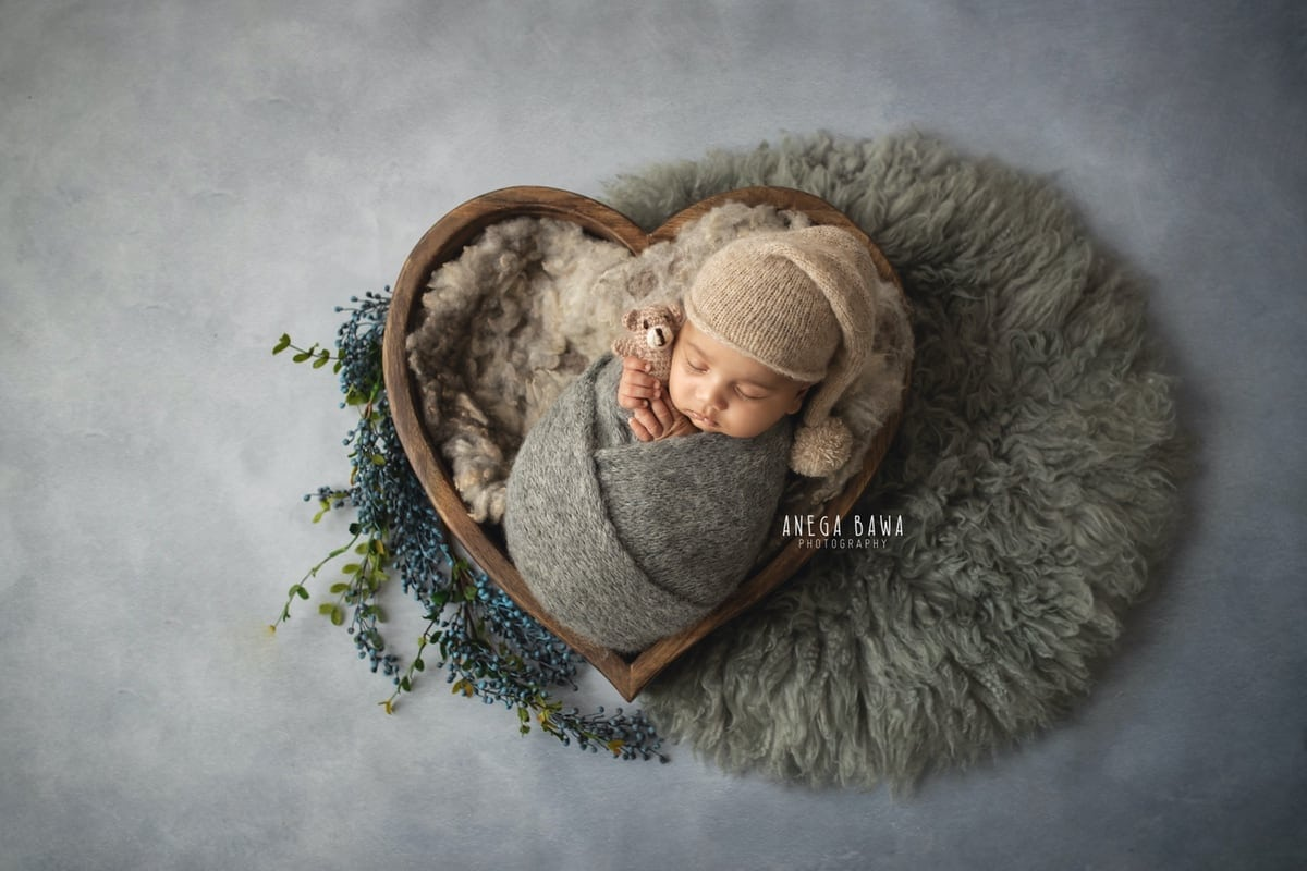 242803-light-grey-background-wooden-heart-grey-wrap-newborn-photography-delhi-12-days-baby-photoshoot-gurgaon-anega-bawa