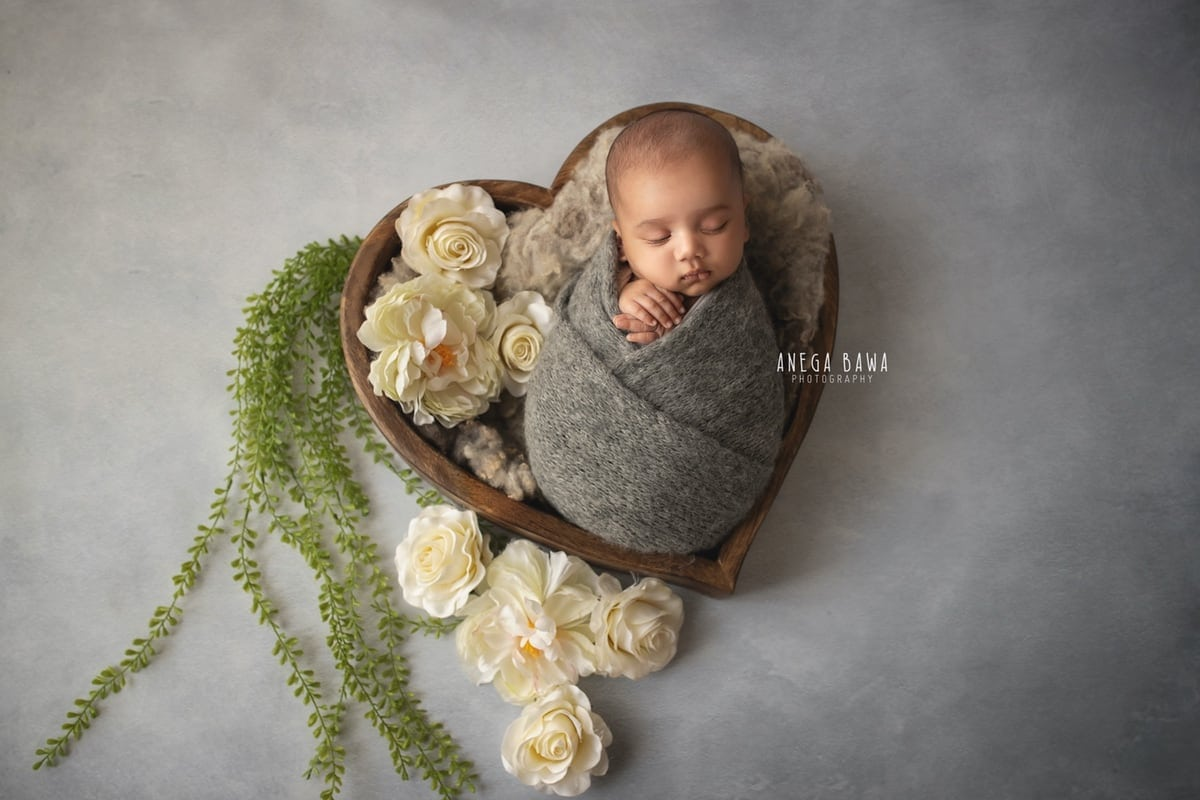 242805-grey-background-white-floral-wooden heart-grey-wrap-newborn-photography-delhi-12-days-baby-photoshoot-gurgaon-anega-bawa