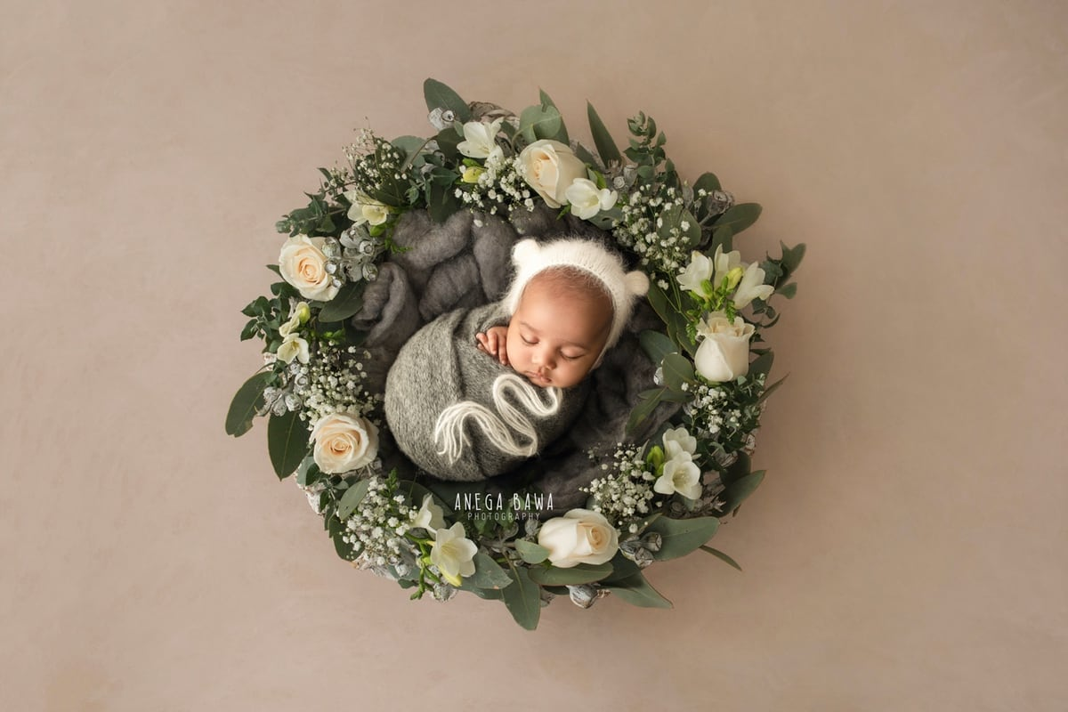 242806-beige-grey-background-white-floral-heart-bowl-grey-wrap-newborn-photography-delhi-12-days-baby-photoshoot-gurgaon-anega-bawa