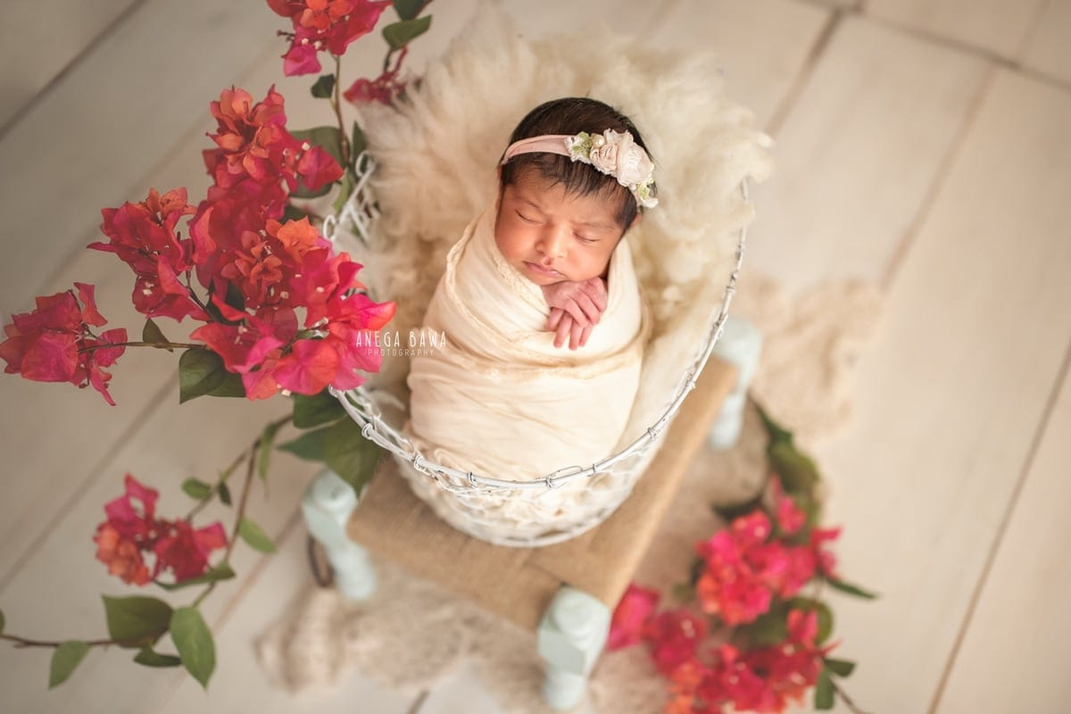 247502-white-wooden-background-pink-floral-newborn-photography-delhi-12-days-baby-girl-photoshoot-gurgaon-anega-bawa