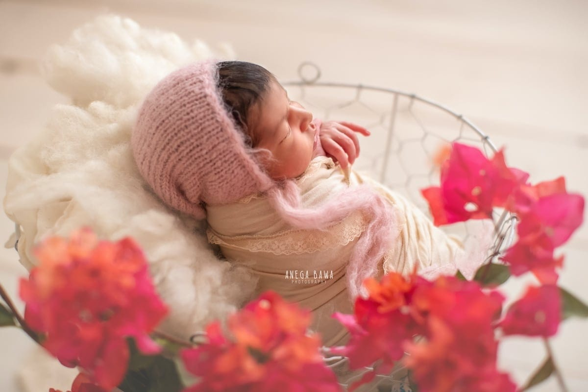 247503-white-wooden-background-pink-floral-pink-headgearnewborn-photography-delhi-12-days-baby-girl-photoshoot-gurgaon-anega-bawa
