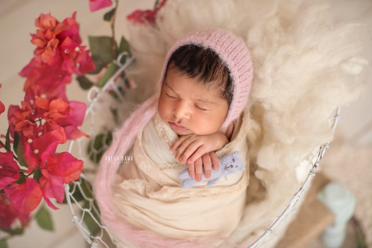247504-white-wooden-background-pink-floral-newborn-photography-delhi-12-days-baby-girl-photoshoot-gurgaon-anega-bawa