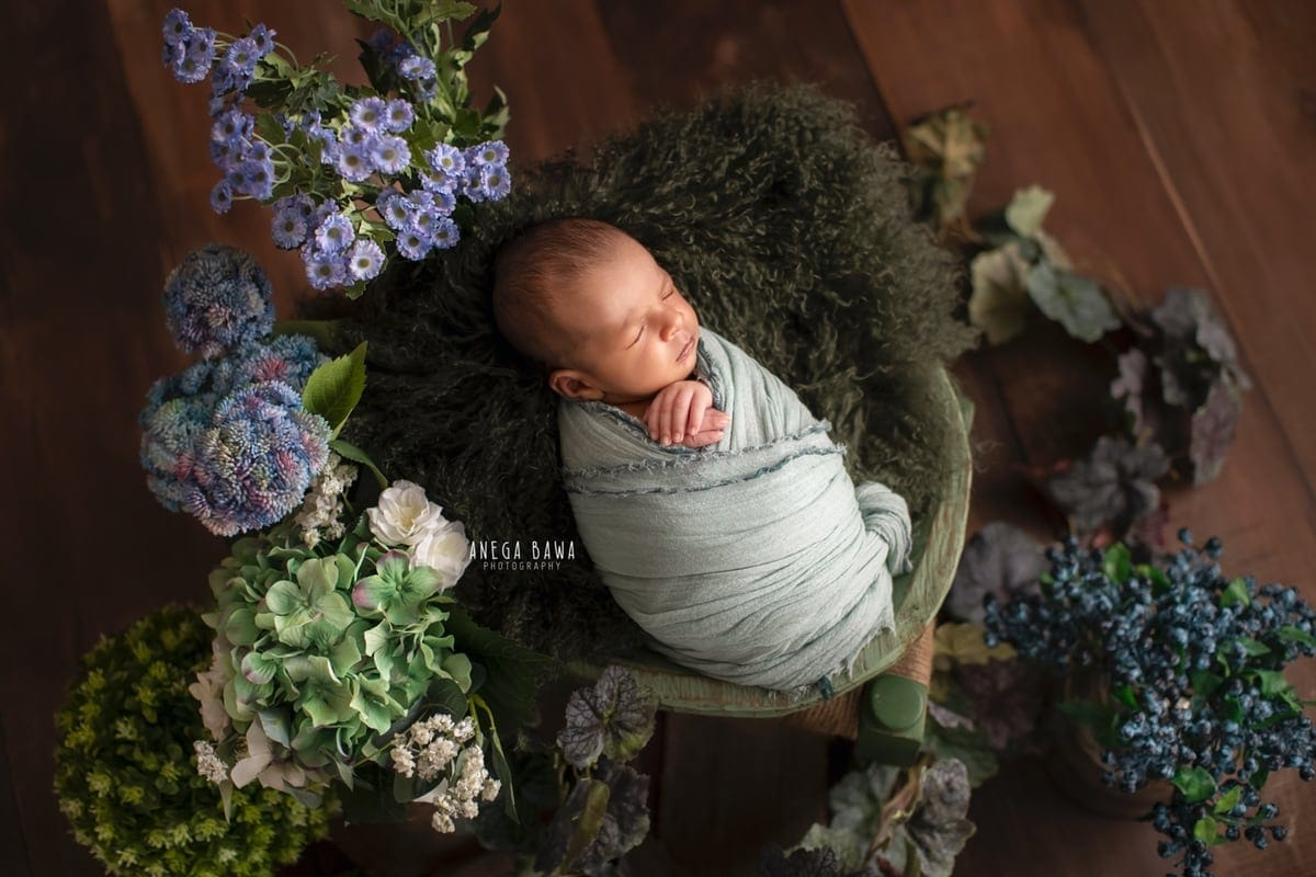 247702-wooden-background-purple-green-floral-teal-wrap-newborn-photography-delhi-15-days-baby-photoshoot-gurgaon-anega-bawa
