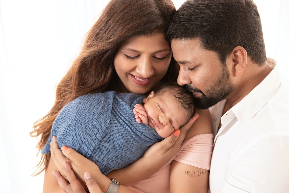 248003-white-background-pink-white-family-newborn-photography-delhi-10-days-baby-photoshoot-gurgaon-anega-bawa