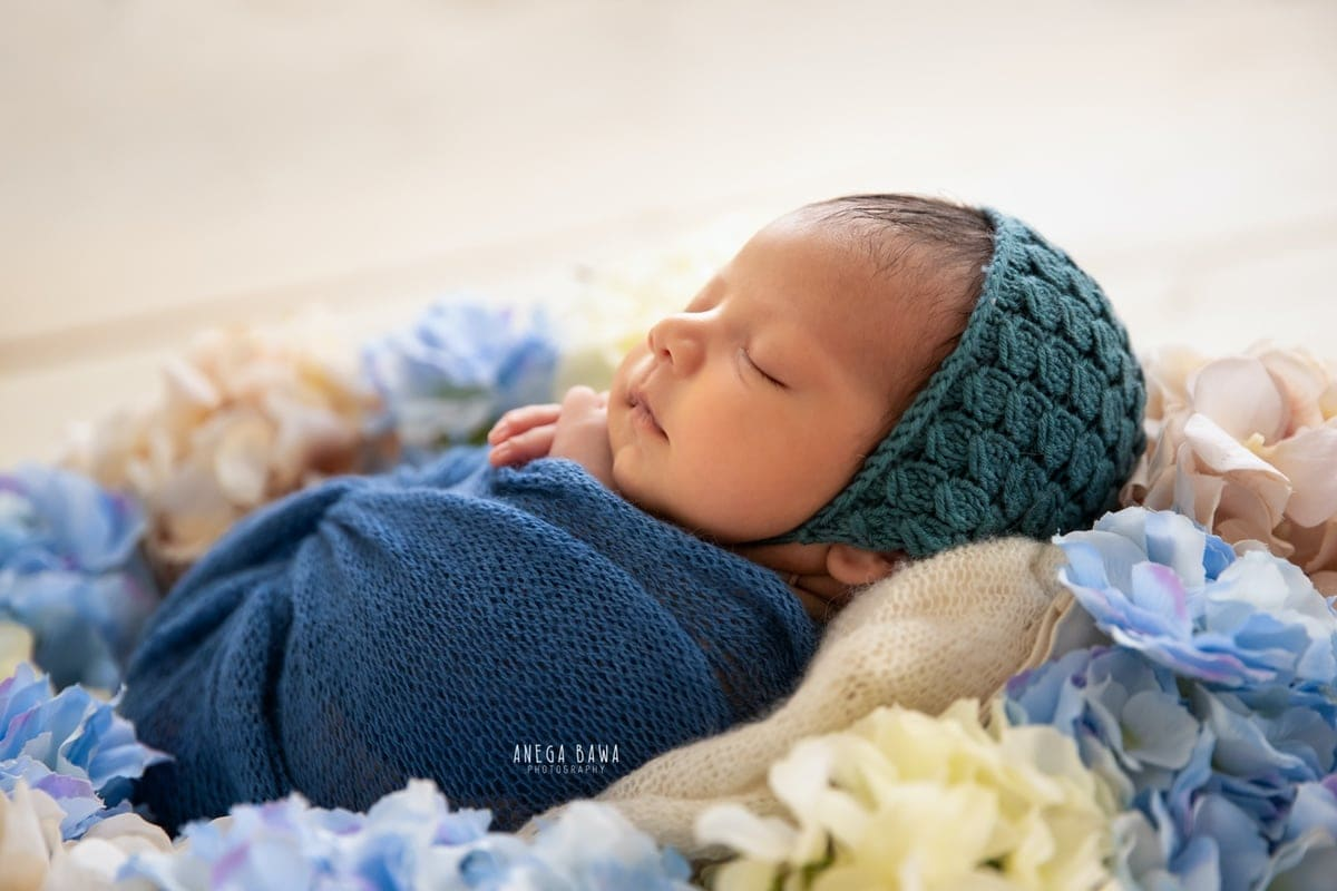 248008-white-background-blue-white-floral-newborn-photography-delhi-10-days-baby-photoshoot-gurgaon-anega-bawa