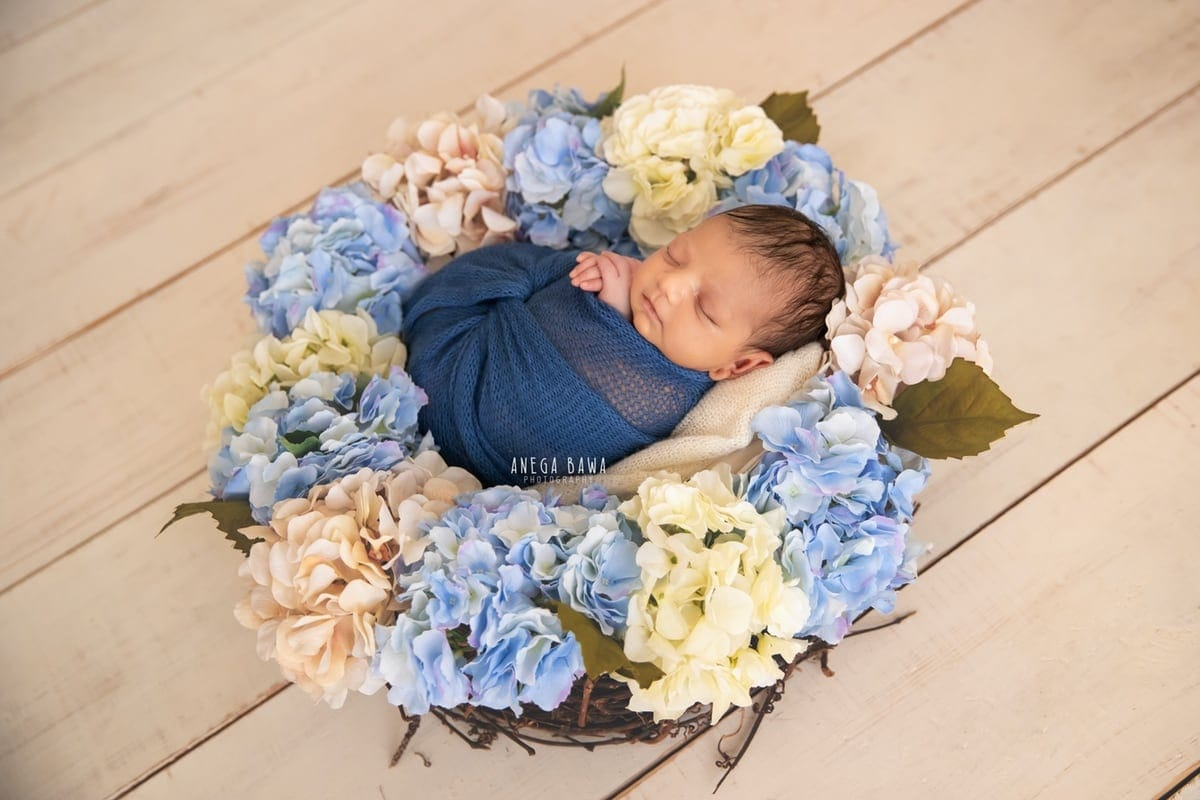 248010-white-wooden-background-blue-white-floral-newborn-photography-delhi-10-days-baby-photoshoot-gurgaon-anega-bawa
