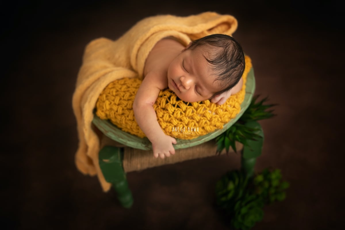 248011-brown-background-yellow-wrap-green-floral-newborn-photography-delhi-10-days-baby-photoshoot-gurgaon-anega-bawa