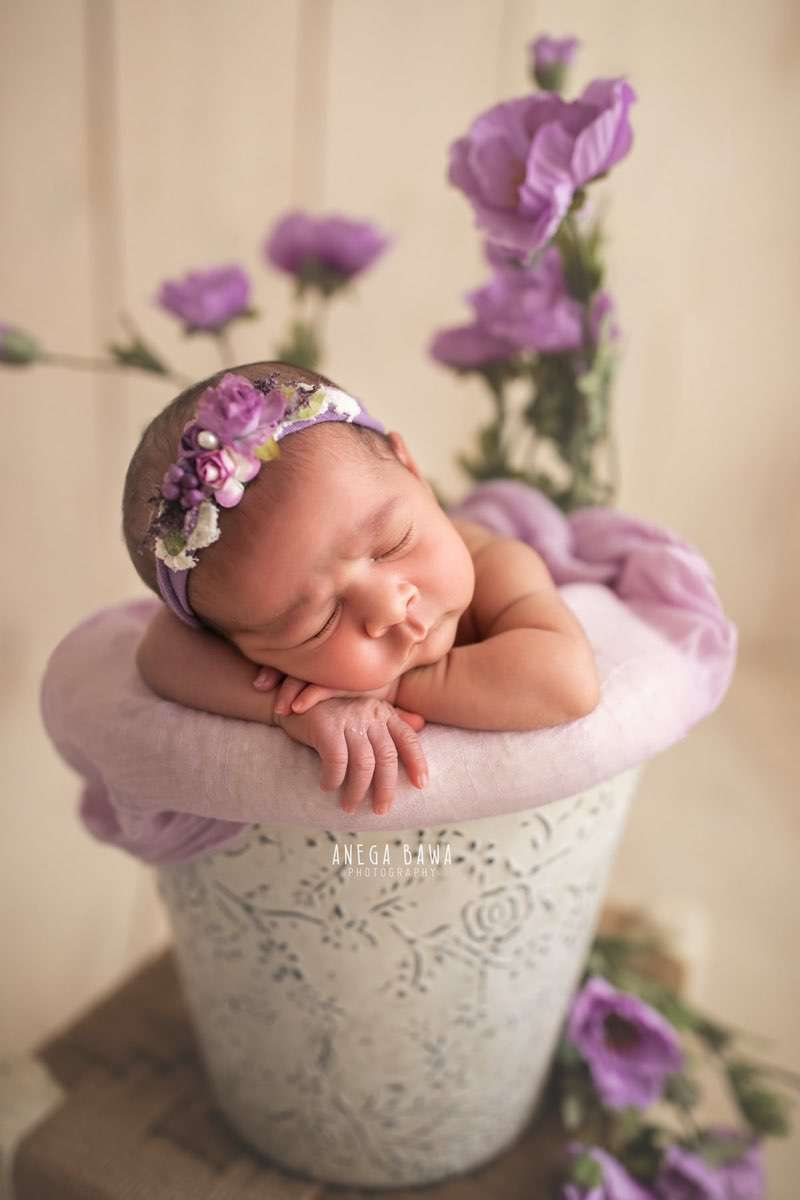 248601-light-wooden-background-purple-floral-lavender-newborn-photography-delhi-20-days-baby-boy-photoshoot-gurgaon-anega-bawa