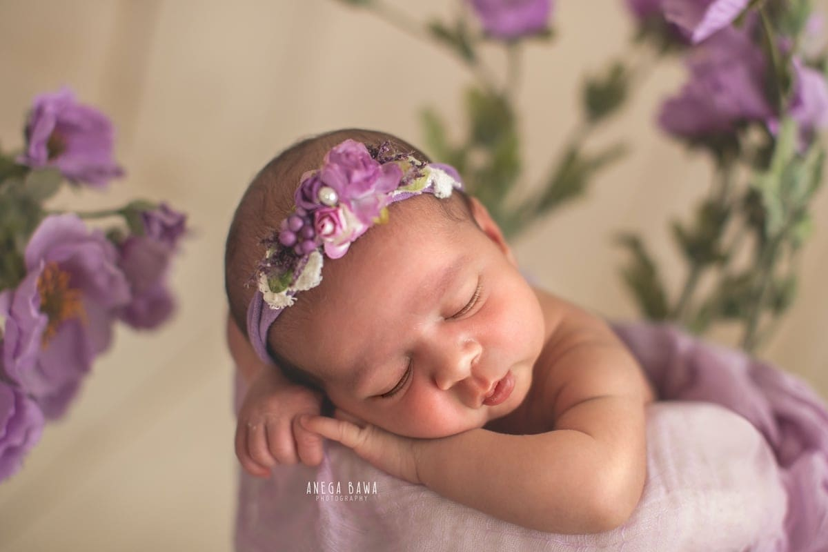 248605-light-wooden-background-purple-floral-lavender-newborn-photography-delhi-20-days-baby-boy-photoshoot-gurgaon-anega-bawa