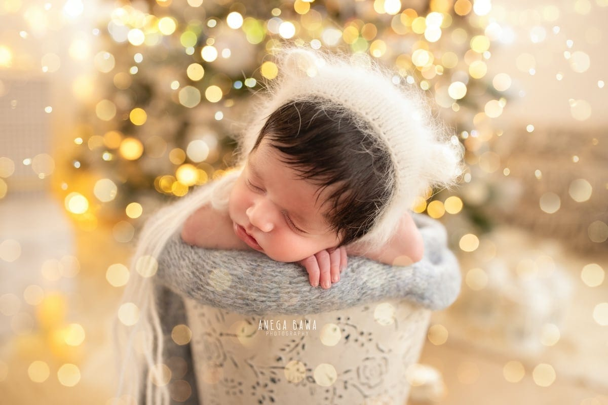 249610-white-christmas-lights-background-white-magical-newborn-photography-delhi-21-days-baby-boy-photoshoot-gurgaon-anega-bawa