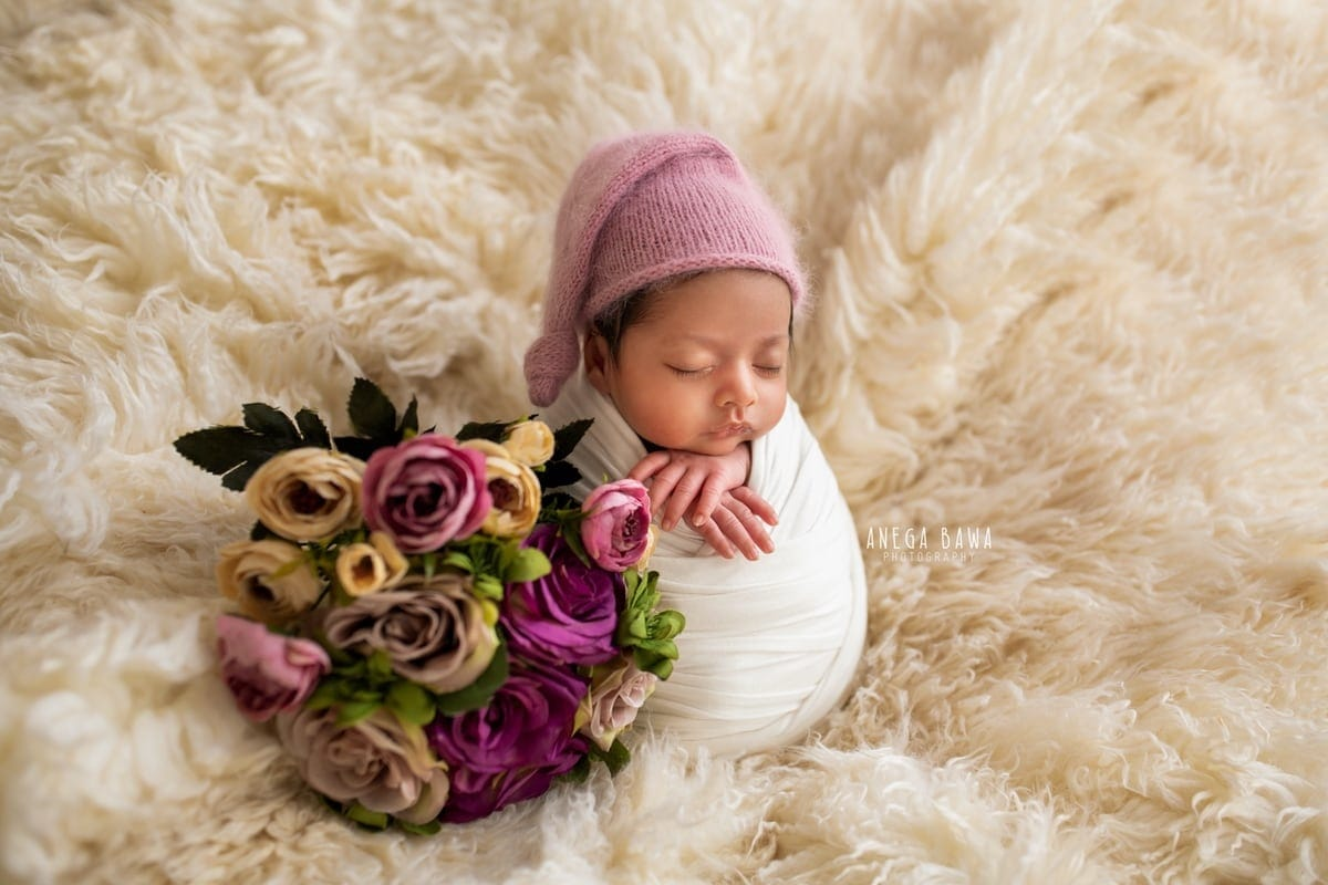 250801-white-background-white-wrap-floral-newborn-photography-delhi-14-days-baby-photoshoot-gurgaon-anega-bawa