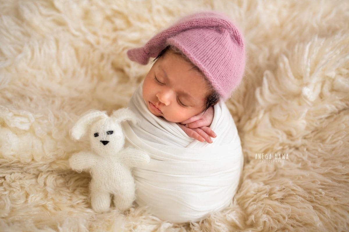 250802-white-background-white-wrap-floral-newborn-photography-delhi-14-days-baby-photoshoot-gurgaon-anega-bawa